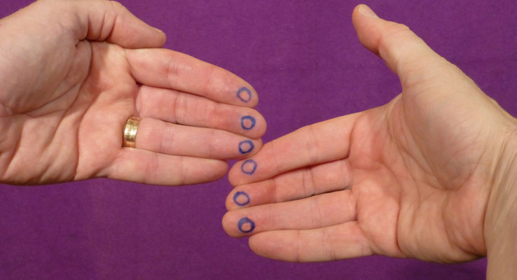 Finger hole locations for the cradle grip
