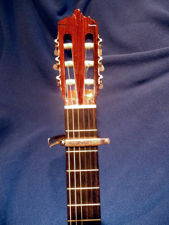 Capo behind the Second fret