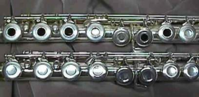 Western concert flutes with two styles of key mechanisms