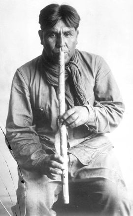 Cipriano Garcia Playing a Papago Flute, 1919