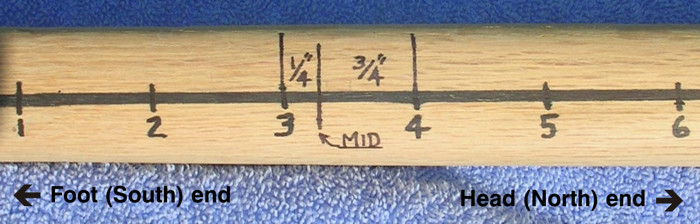 Flute marked for equally-spaced finger holes.