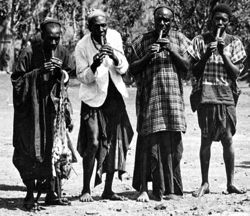 "Four dignitaries playing the ""lela"" flutes at the ""lela"" celebration in Bali. Photo: Bernhard Ankermann, 1907–1909"