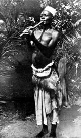 "Ganda musician playing the notched flute ""endere"". Photo: J. F. Cunningham, 1905"