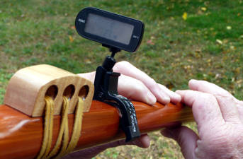Electronic tuner clipped to the body of a flute. Setup of John LaRocque.