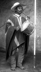 Musician from Eten with one-hand flute and cylinder drum (undated)
